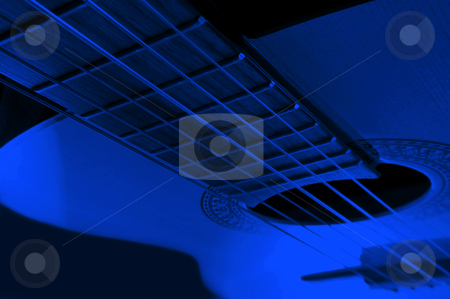 Acoustic guitar stock photo, Acoustic guitar with extreme blue light effect. by Samantha Craddock