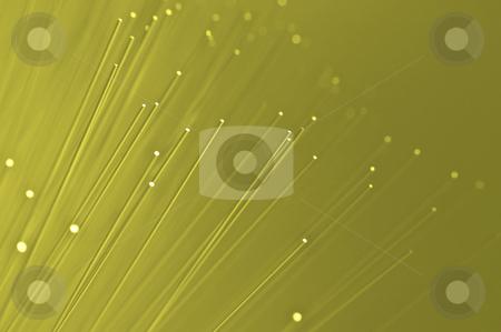 Telecommunications background stock photo, Many ends of yellow illuminated fiber optic light strands close up by Samantha Craddock