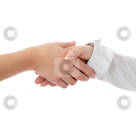 Closeup of a business hand shake stock photo, Closeup of a business hand shake between two colleagues by Piotr_Marcinski