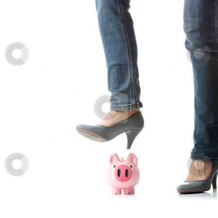 Piggy bank execution stock photo, Young woman about to smash piggy bank with her legto get at savings by Piotr_Marcinski