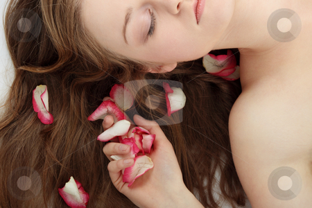 Beauty stock photo, Close-up of beautiful young woman face with long blond hair and rose-petal by Piotr_Marcinski