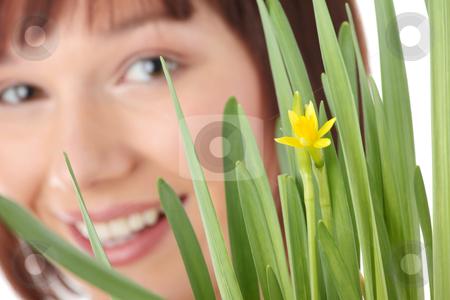 Spring girl stock photo, Spring girl with flower portrait, over white background - focus on flower by Piotr_Marcinski
