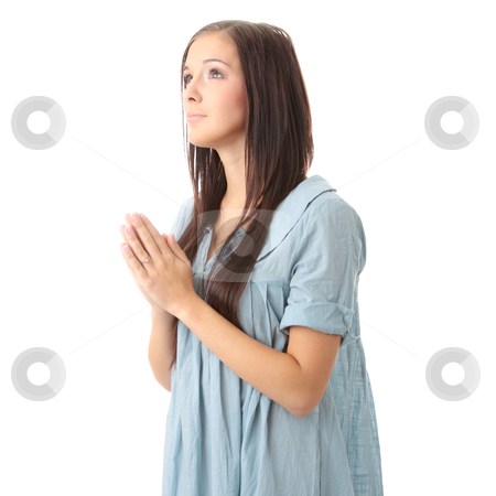 Pray stock photo, Closeup portrait of a young caucasian woman praying isolated on white background  by Piotr_Marcinski