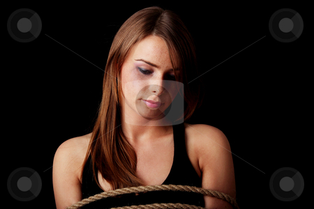 Emotional portrait of abused woman stock photo, Emotional portrait of abused woman isolated on black    by Piotr_Marcinski