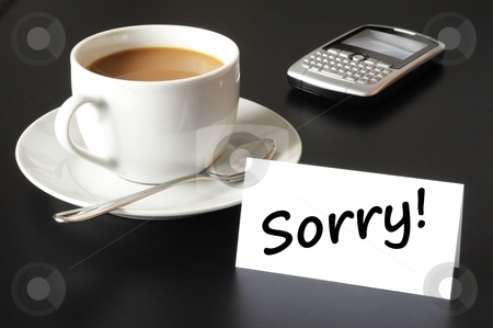 Sorry stock photo, sorry message on paper and cup of coffe on black by Gunnar Pippel
