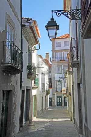 Old street stock photo, View from an old street in Viana do Castelo, Portugal by Neonn