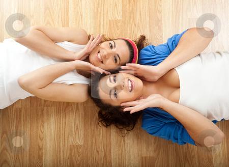 Beautiful young women's stock photo, Portraits of two beautiful young women on the floor by ikostudio