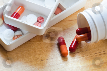 Tablets, capsules and pills sorted in pillbox  stock photo, Tablets, capsules and pills sorted in medicine box for use as daily medication by Colette Planken-Kooij