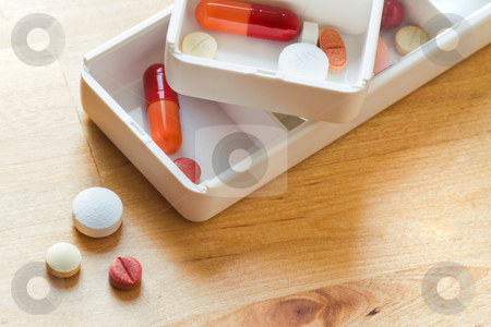 Sorting pills in pillbox for daily use stock photo, Pills, tablets and capsules sorted in pillboxes for daily use as medication by Colette Planken-Kooij