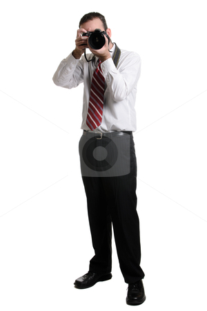 Photographer stock photo, A full length view of a photographer using a DSLR, isolated against a white background. by Richard Nelson
