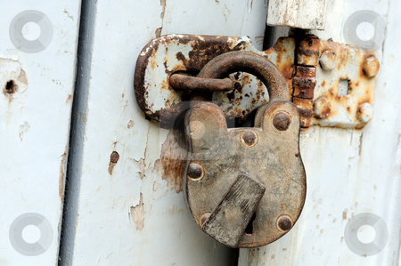 Locked stock photo, an ancient woodedn door locaked with a lock by Arvind Balaraman
