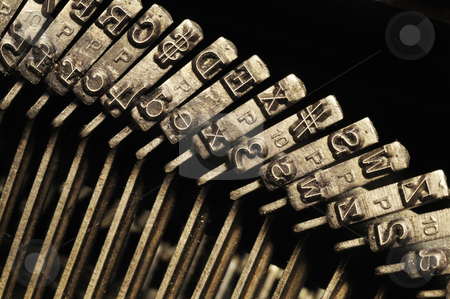 Close-up of old typewriter letter and symbol keys  stock photo, Close-up of the striking surface of old typewriter letter and symbol keys by J.R. Bale