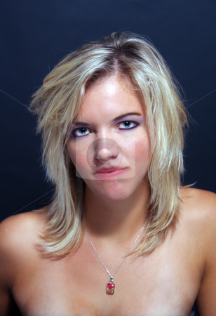Attractive Blonde Headshot (1) stock photo, A studio close-up of a lovely young blonde with a neutral facial expression. by Carl Stewart