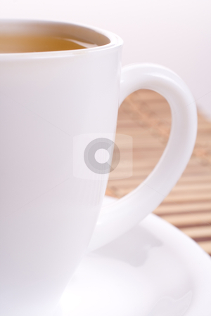 White cup of tea stock photo, a white cup of tea standing on the table by Artem Zamula