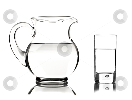 Glass and glass pitcher on white background stock photo, Glass and glass pitcher on white background with space for text by tish1