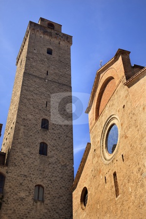 Collegiate Church Cross Costarella Tower Torre Grosse Rognosa Sa stock photo, Collegiate Church S. Maria Assunta Facade Stained Glass Tower Grosse Rognosa San Gimignano Tuscany Italy San Gimignano is a medieval town and the Towers were build for defense. by William Perry