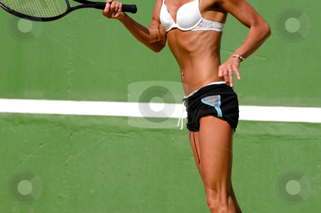 Woman playing tennis stock photo, Woman is playing tennis on a warm sunny day. by Lars Christensen