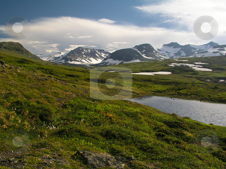 Landscape of whilderness stock photo,  Landscape of snow mountains and green field  by Sasas Design