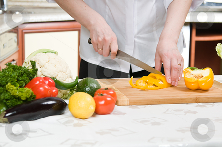 Cooking stock photo, beautiful woman prepares food in the kitchen by Salauyou Yury