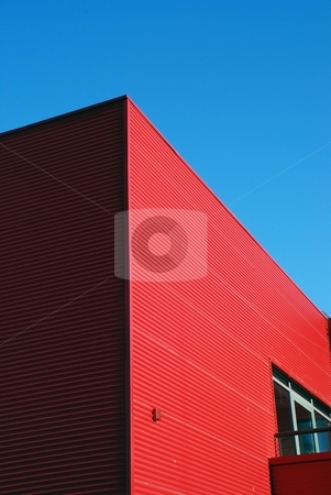 House wall made of tin.  stock photo, Corner of house which walls made of red tin.  by sauletas