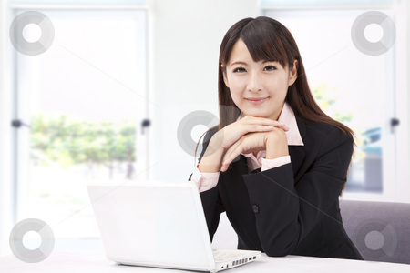 Beautiful businesswoman with laptop stock photo, Beautiful businesswoman with laptop by tomwang