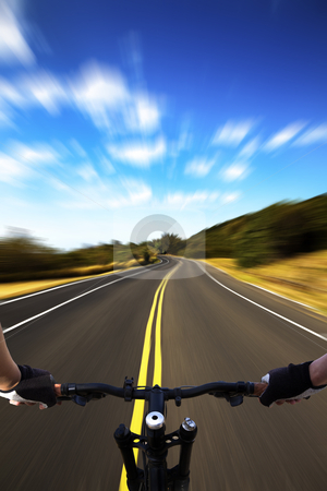 Bicycle rider with high speed view on the road stock photo, Bicycle rider with high speed view on the road by tomwang