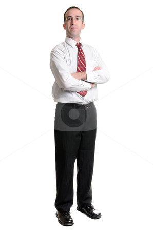 Businessman On White stock photo, A young businessman standing with his arms crossed, isolated on a white background by Richard Nelson