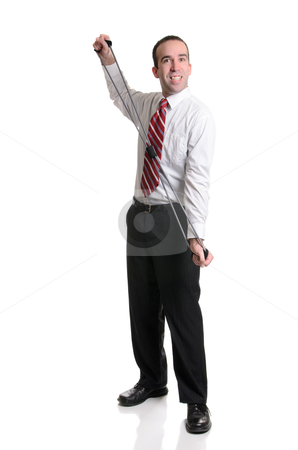 Fun Exercises stock photo, A full body view of a young businessman having fun using a resistance band to do some exercises, isolated against a white background. by Richard Nelson