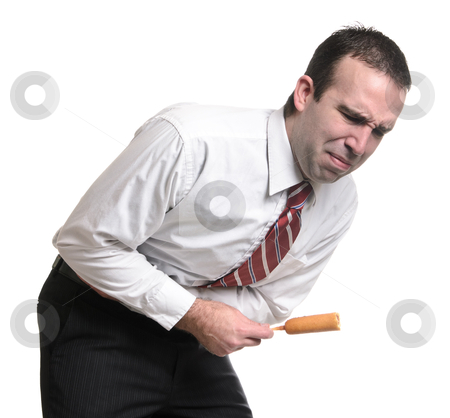 Food Born Illness stock photo, A young man suffering from a stomach ache due to eating a bad corn dog. Isolated against a white background. by Richard Nelson