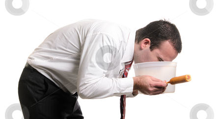 Food Poisoning stock photo, A young man is vomiting into a pail after eating a bad corn dog and getting food poisoning, isolated against a white background. by Richard Nelson