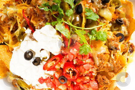 Fresh nachos and vegetable salad with meat stock photo, fresh nachos and vegetable salad with meat ,chili con carne  ,tipycal mexican food by Francesco Perre
