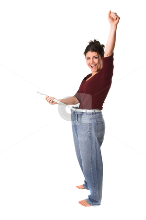 Successfully loosing weight stock photo, pretty brunette with a measuring tape around her waist successfully having lost weight by Simone Van den Berg