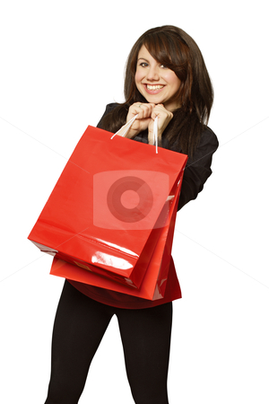 Retail therapy stock photo, A very happy shopping girl holding bags and filled with glee.  by © Ron Sumners