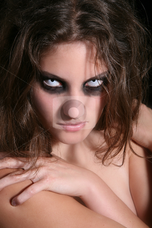 Scary creature stock photo, Pretty woman with very scary white eyes and dark makeup by Simone Van den Berg