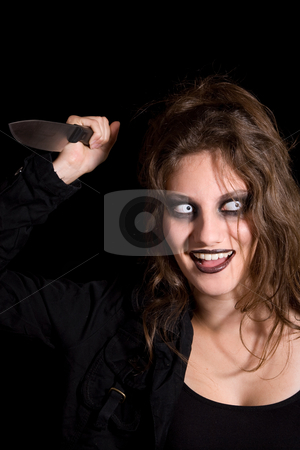 Dangerous creature stock photo, Dangerous looking woman with scary eyes and a knife in her hand by Simone Van den Berg