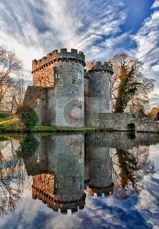 Whittington Castle in Shropshire reflecting on moat stock photo, Ancient Whittington Castle in Shropshire, England reflecting in a calm moat round the stone buildings and processed in HDR by Steven Heap
