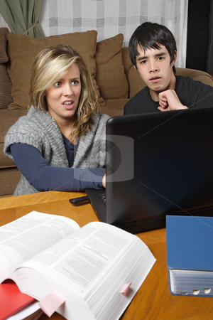 Bad internet browsing experience stock photo, Two students doing homework come across something bad while browsing the internet. by © Ron Sumners