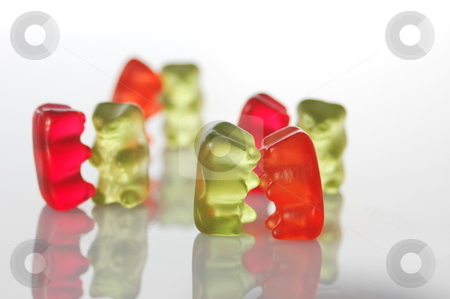 Gummy bears dancing at a party stock photo, sweet gummy bears dancing on a party on white background by Gunnar Pippel