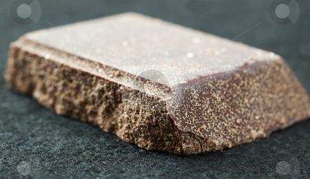 Chocolate stock photo, Big piece of dark chocolate, shallow DOF by Fabio Alcini