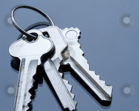 Key ring and keys stock photo, three keys on a keyring with cold coloured lighting, concept of security by Stephen Gibson