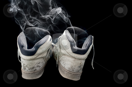 Smelly old sneakers stock photo, dirty old pair of sneakers on a black background by Stephen Gibson