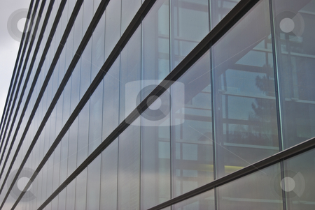 Modern building stock photo, detail of a modern building made of glass and steel by Juliane Jacobs