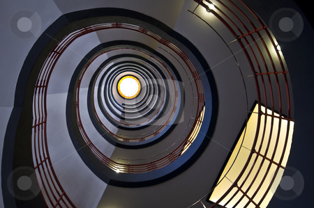 Spiral staircase stock photo, looking upwards in a beautiful old spiral staircase by Juliane Jacobs