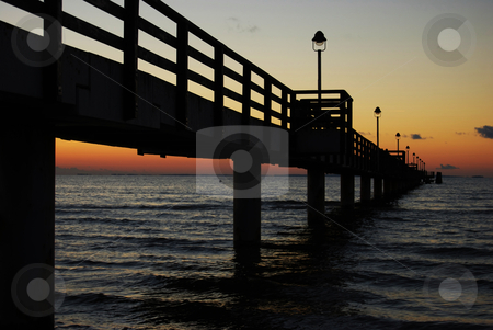 Pier at night stock photo, pier going out into the Baltic Sea at dusk by Juliane Jacobs