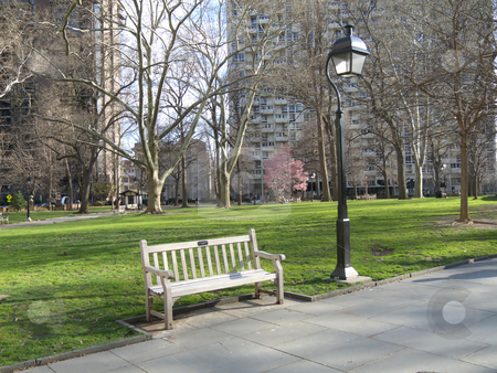 Bench stock photo, lonely bench in a park in springtime by Juliane Jacobs