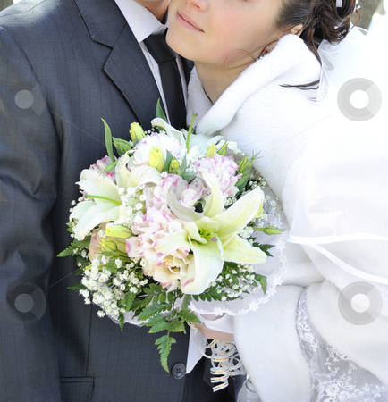 Wedding bouquet stock photo, Beautiful wedding bouquet in hands of the bride.  by Pavel Vorobyov