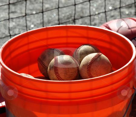 Bucket of ball stock photo, a closeup view of an orange ball bucket  by Tim Markley