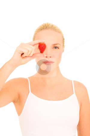 Woman with a strawberry on eye stock photo, woman with a strawberry on eye  by ambrophoto