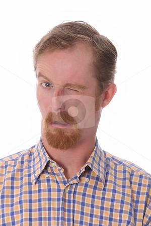 Winking man stock photo, Portrait of winking man on white background by vladacanon1