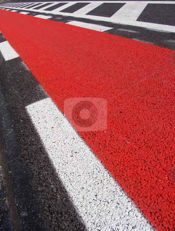 Freshly laid asphalt road with red bicycle path freshly spray pa stock photo, freshly laid asphalt road with red bicycle path freshly spray painted by johnjohnson